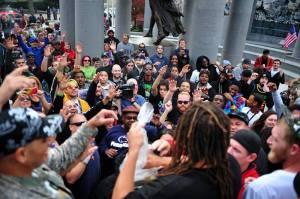 NJ Weedman tossing edibles to the large crowd at the State House on October 18, 2014.