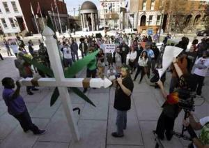 "NJ Weeman with the ""Weed Cross"" in front of the NJ State House on April 20, 2014."