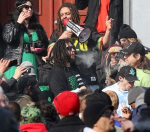 Around 300 persons smoke at 4:20 P.M. across the State House. (Photo from nj.com)