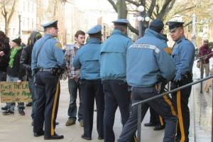 Organizer Kyle Moore speaking with police at State House. (Photo by Ken Wolski)