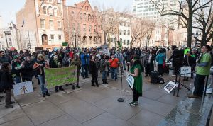 Vanessa Maria speaking to 350 demonstrators at the State House. (Picture from nj.com)