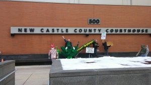 Uncle Sam, Weed Woman, Hempy, and Kyle Moore at the New Castle County Courthouse.  NORML member Mike Murray is holding the 8-foot bong.