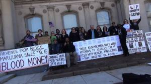 Weekly demonstrators gather for the first cannabis Speak-Out at the State House on April 2, 2015.