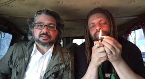 NJ Weedman lighting up in the Weedmobile next to NJ.com reporter. (Photo from NJ.com)