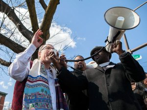 Religious leaders speaking in support of unions and economic justice on April 4. (Photo from Philly.com)