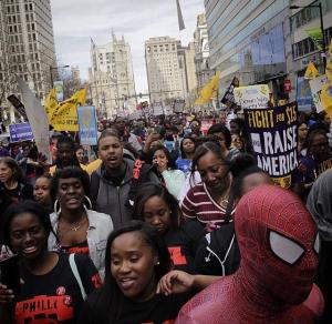 Spiderman joins 500 marchers for 15 Now in Philly, Wednesday, April 15.