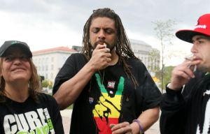 From Left to Right: Cindy Ruggiero, NJ Weedman, and David Okrod lighting up at City Hall. (Photo by NJ.com)