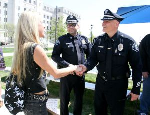 Demonstrator shaking hands with Camden police. (Photo in NJ.com)