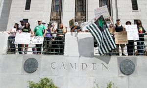 Demonstrators in front of City Hall. (Photo by NJ.com)