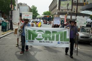 Philly NORML leading march down South Street. Photo by Mike Whiter.