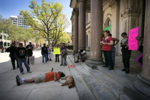 Karen Walden speaking, while Weedman does pre-die-in. Photo from NJ.com.