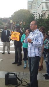 Ex-police officer Richard Rivera speaking at rally outside War Memorial. (Photo by Rev. Mjumbe)